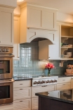 Corner Open Shelving and Hood with Plate Rail and Arched Valance